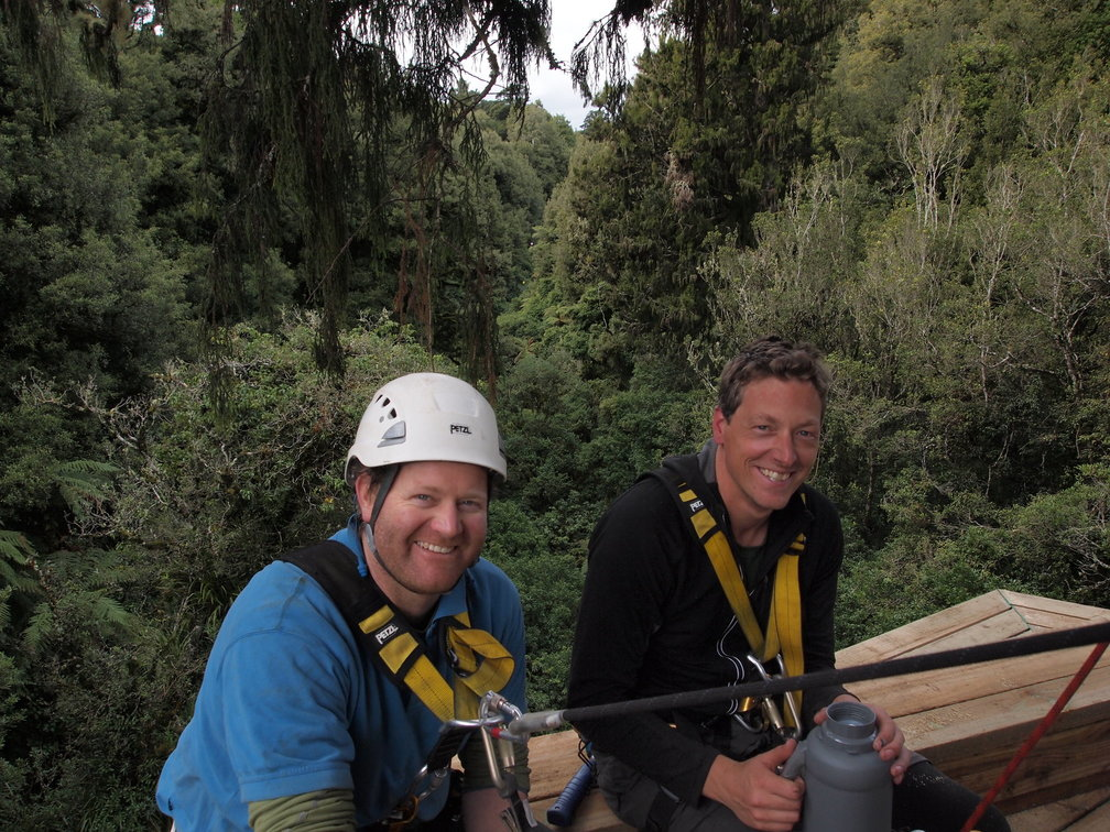 Andrew and Nick sitting on the new platform at the start of the longest zipline